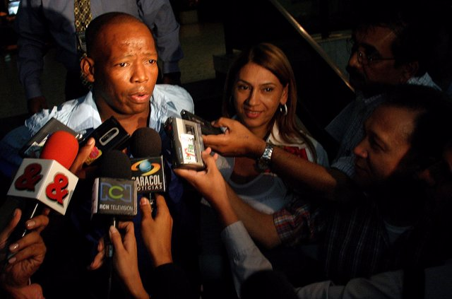 Former Colombian soccer player Faustino Asprilla talks to reporters in Cali, Col