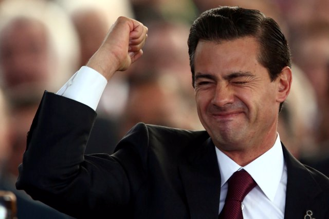 Mexico's President Enrique Pena Nieto gestures during the 80th anniversary of th