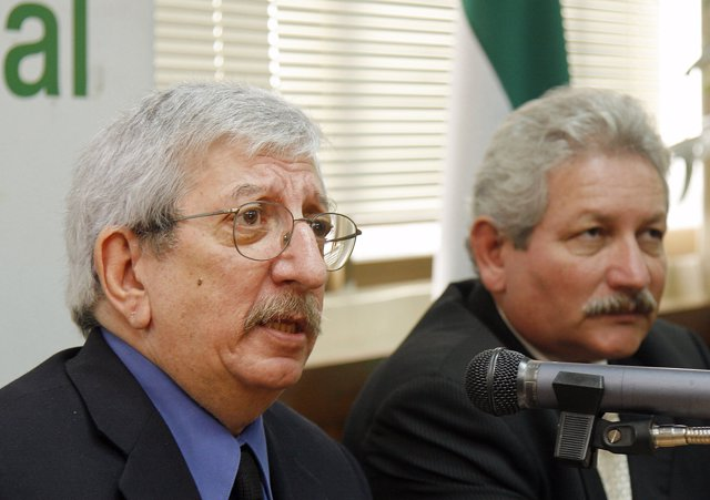 Argentine Dante Caputo (R), envoy for the Organization of American States (OAS),