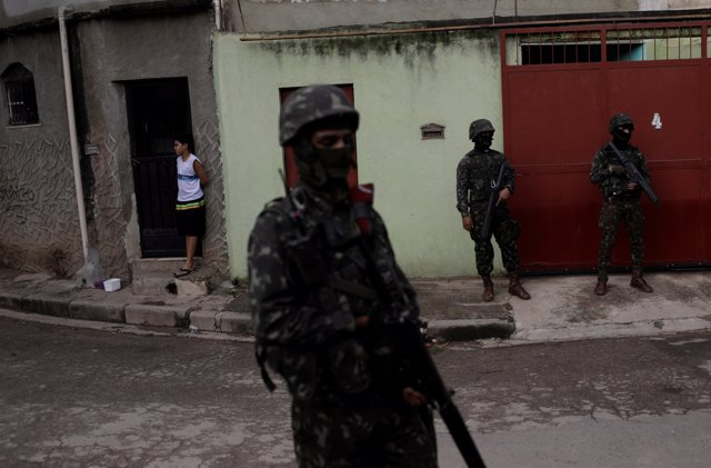 Brazilian Army soldiers patrol during an operation against drug dealers in the C