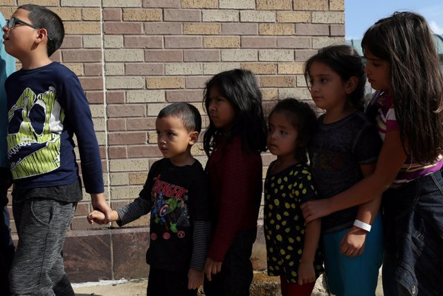 Children form a line as undocumented immigrant families are released from detent