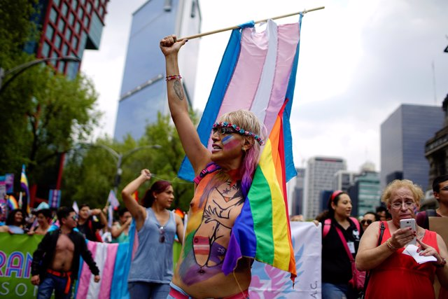 A participant of a Gay Pride Parade shouts slogans during a march in Mexico City