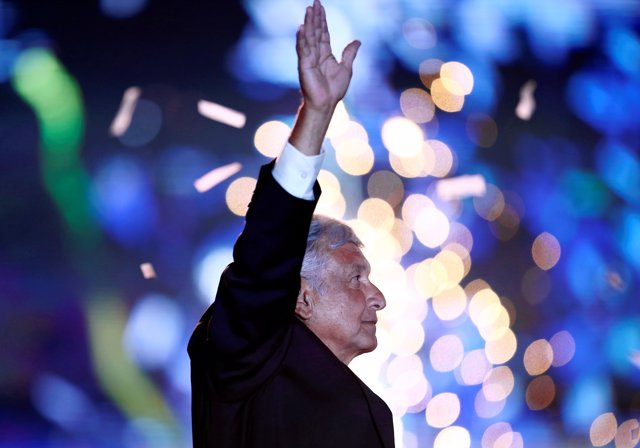 Mexican presidential candidate Andres Manuel Lopez Obrador waves to supporters d