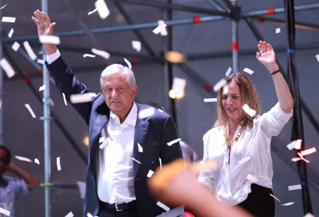 Presidential candidate Andres Manuel Lopez Obrador gestures with his wife Beatri