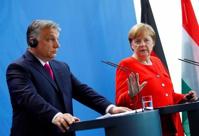 Viktor Orban y Angela Merkel