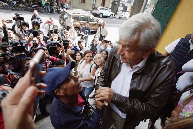 Mexican President-elected Andres Manuel Lopez Obrador greats to supporters as he