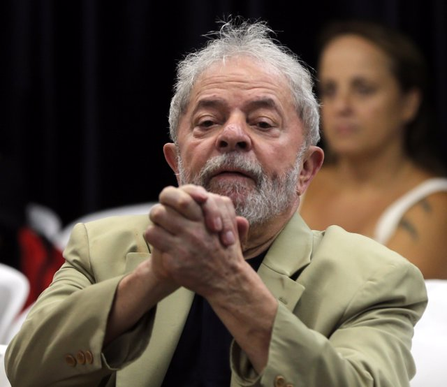 Former Brazilian President Luiz Inacio Lula da Silva reacts at his book launch e