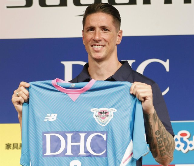 Spain soccer player Fernando Torres poses with his new Sagan Tosu football club