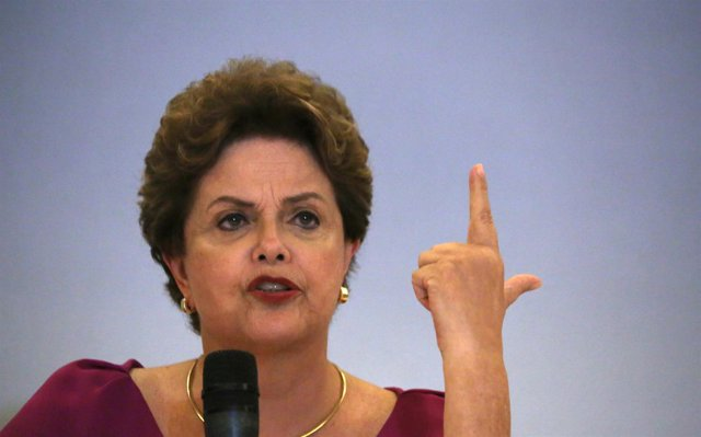 Former Brazilian President Dilma Rousseff speaks during a news conference in Rio