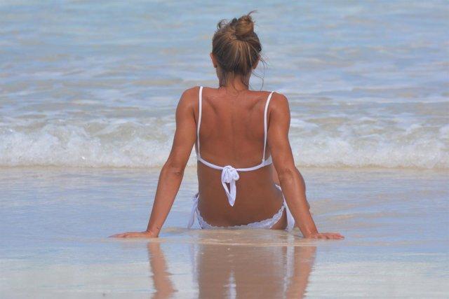 Tomar el sol, playa, vacaciones, melanoma