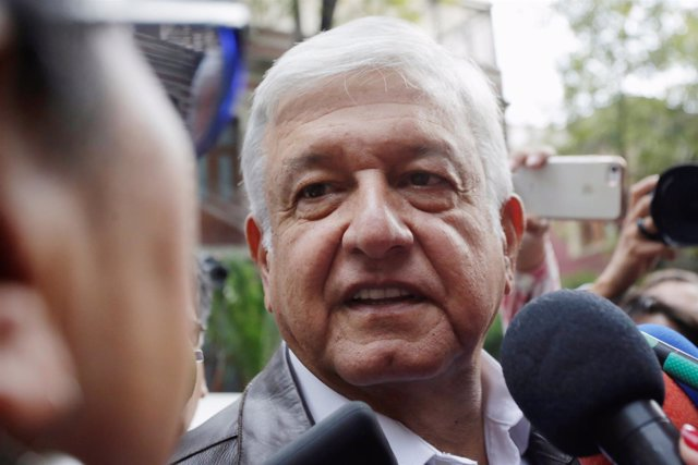 Mexican President-elected Andres Manuel Lopez Obrador talks to a journalist as h