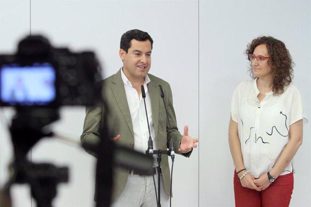 Juanma Moreno y Nuria López en rueda de prensa tras reunirse en la sede del PP-A