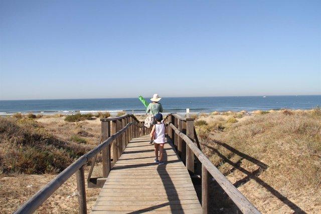 Playa de Huelva. Turista.