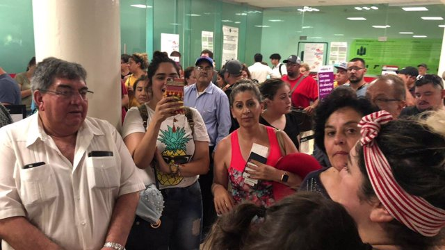 People wait in the Durango Airport after an Aeromexico-operated Embraer passenge