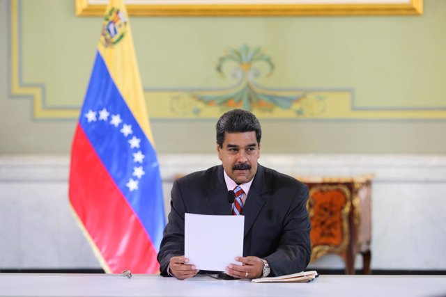 Venezuela's President Nicolas Maduro attends a meeting with banks and financial
