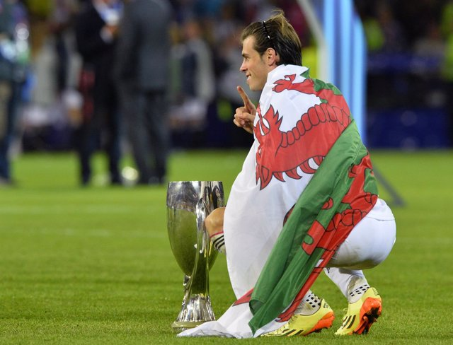Gareth Bale poses with the trophy after winning the UEFA SuperCup