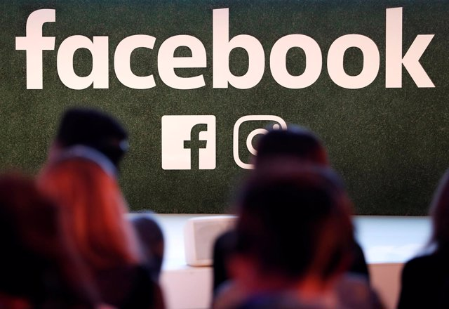 FILE PHOTO: A Facebook logo is seen at the Facebook Gather conference in Brussel
