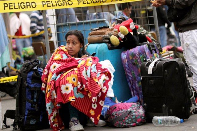 Una migrante venezolana en un paso fronterizo en Ecuador