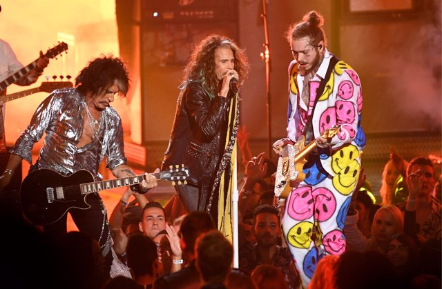 Post Malone (right) performs with Joe Perry (left) and Steven Tyler of Aerosmith