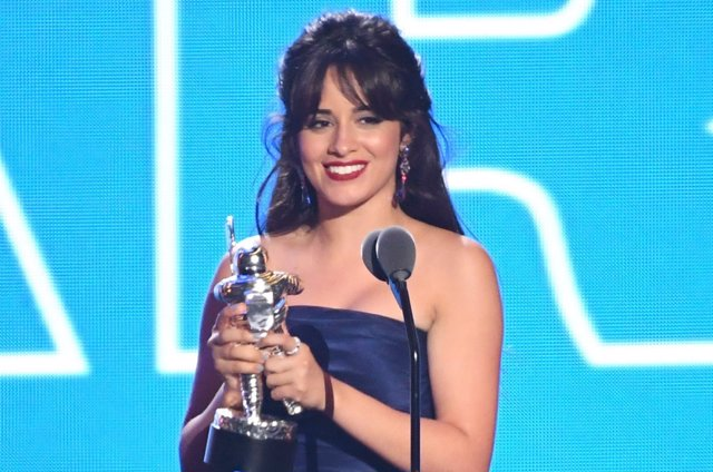 Camila Cabello accepts the award for Artist of the Year on stage at the 2018 MTV