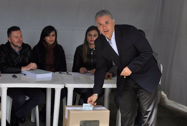 Colombia's President Ivan Duque votes in a seven-question referendum on anti-cor