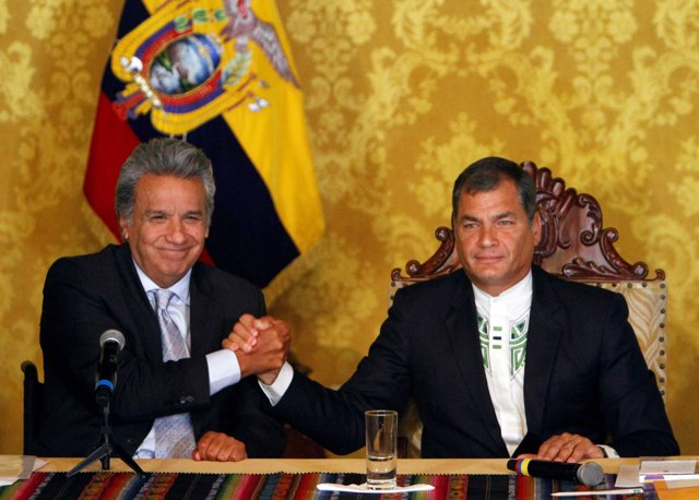 Ecuador's President-elect Lenin Moreno (L) and President Rafael Correa shake han
