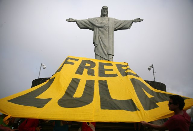 Supporters of former Brazilian President Luiz Inacio Lula da Silva display a ban