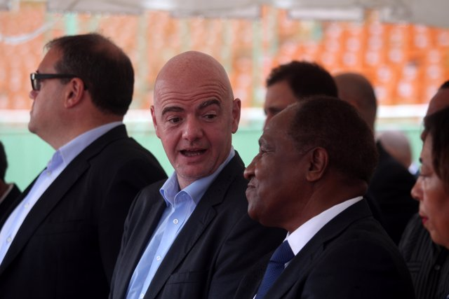 President of CONCACAF Victor Montagliani (L), FIFA President Gianni Infantino (C
