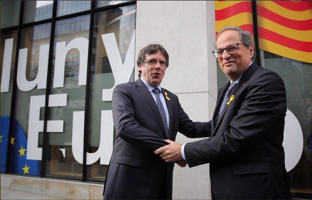 El expte.C.Puigdemont y el pte.Q.Torra en una imagen de archivo.