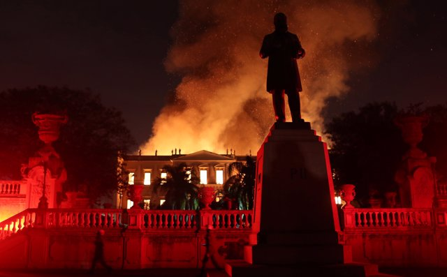 Firefighters try to extinguish a fire at the National Museum of Brazil in Rio de