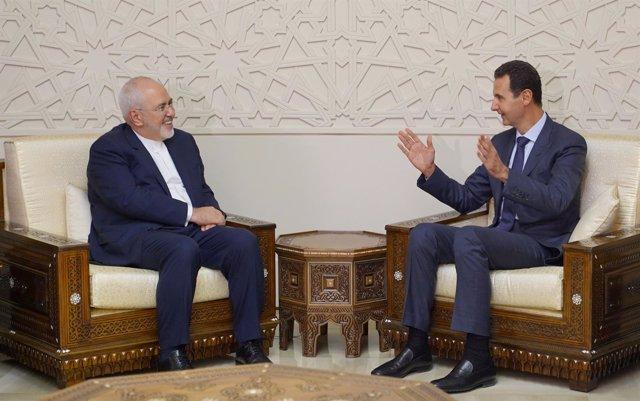 Mohammad Javad Zarif y Bashar al Assad