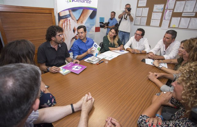 El presidente del PP-A, Juanma Moreno, en un acto sobre inmigración en Huelva