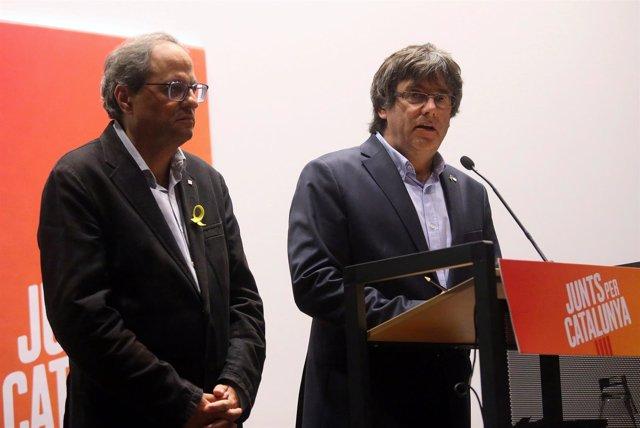 Quim Torra y Puigdemont en una rueda de prensa en Bruselas