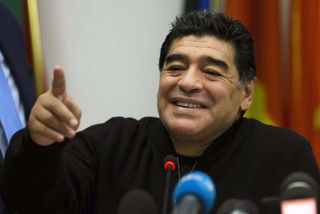 Former Argentine soccer player Diego Maradona reacts during a news conference at