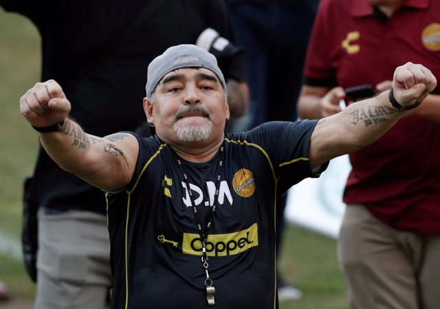 Argentinian soccer legend Diego Armando Maradona reacts to fans during his first