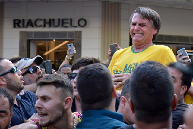 FILE PHOTO: Brazilian presidential candidate Jair Bolsonaro reacts after being s