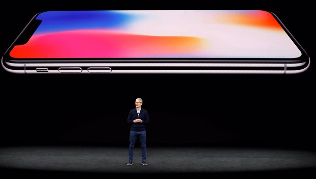 Tim Cook, CEO of Apple, speaks about the iPhone X during a launch event in Cuper
