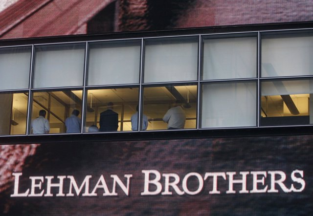 People sit in the window at the Lehman Brothers building in New York September 1