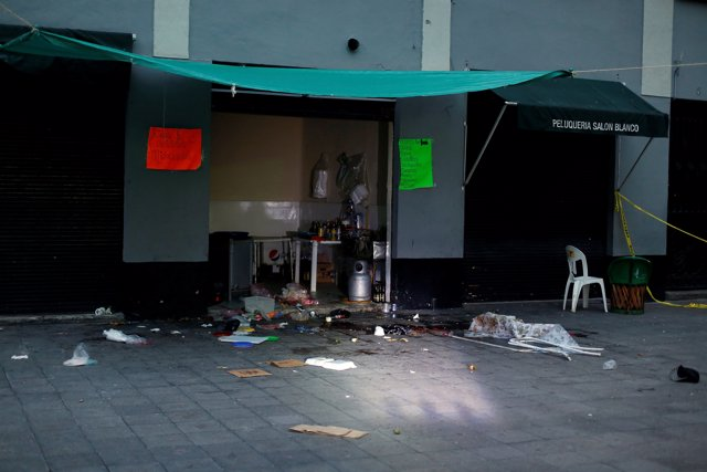 A view of a crime scene hours after unknown assailants attacked people with rifl