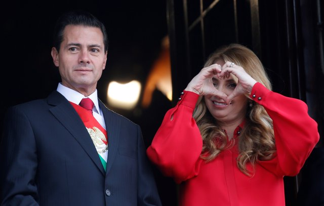 Mexico's President Enrique Pena Nieto looks on as first lady Angelica Rivera mak