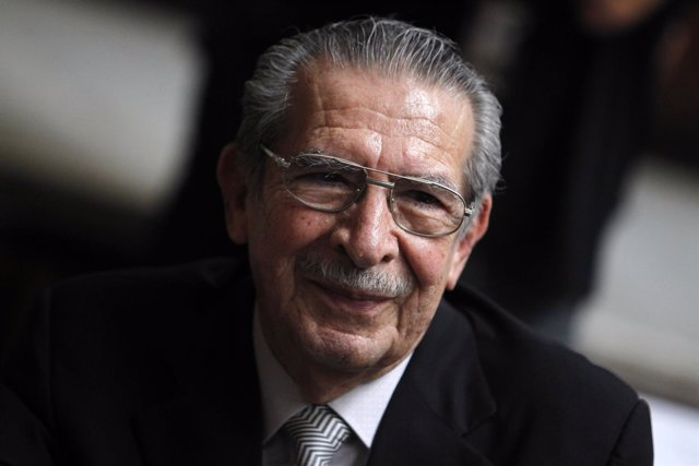 Former Guatemalan dictator Rios Montt smiles during his genocide trial