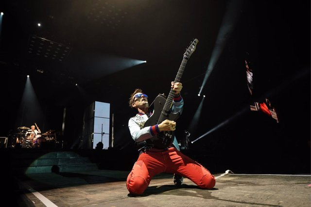 Matt Bellamy of Muse performing in the final headline slot on the Main Stage at