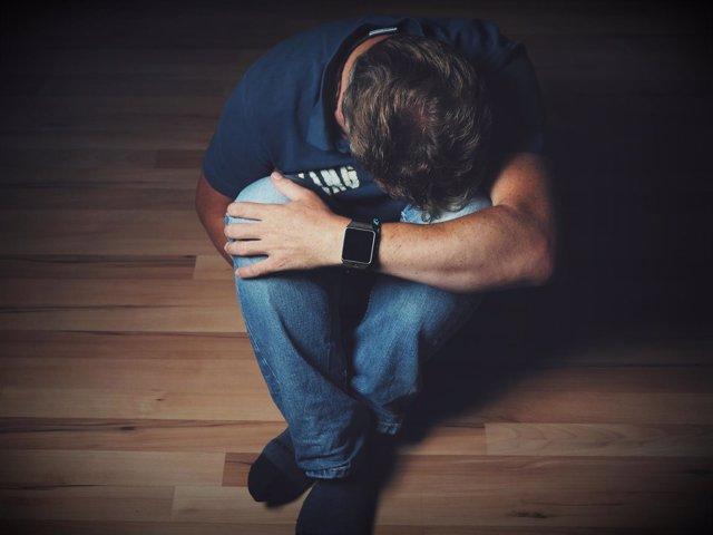 Depresión, hombre deprimido