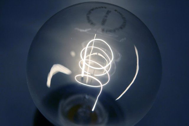 A traditional light bulb with carbon filament is displayed at a do-it-yourself s