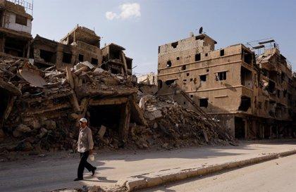 La guerra siria convierte al enclave palestino de Yarmuk en una ciudad fantasma