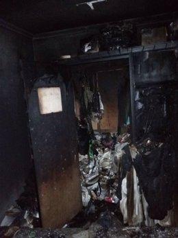 Los daños causados por el fuego en el piso de la calle Mayor de Pamplona