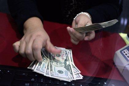 Venezuela anuncia la eliminación del dólar del sistema cambiario oficial