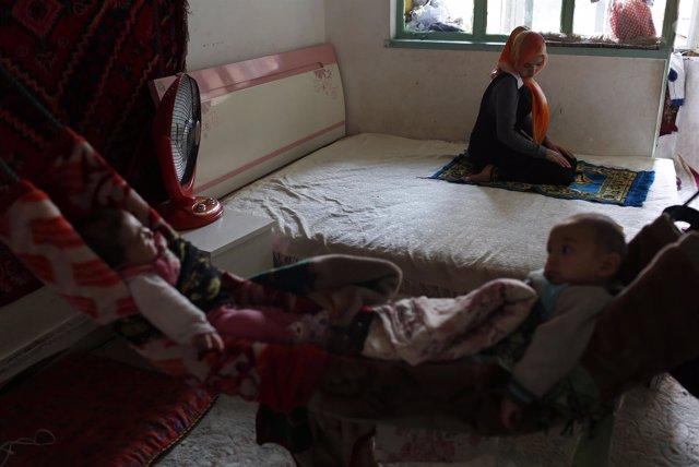 A Uighur family spends their afternoon at their home