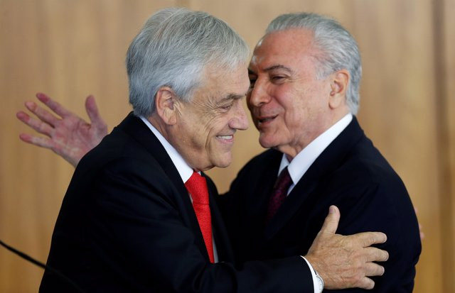 Chile's President Sebastian Pinera is greeted by Brazilian President Michel Teme