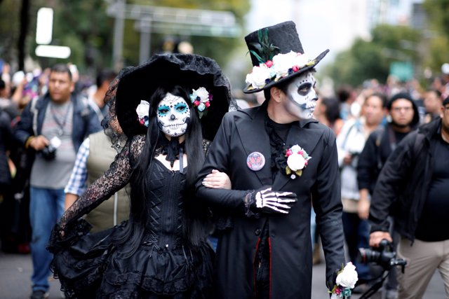 A couple takes part in a Catrina parade ahead of the Day of the Dead in Mexico C